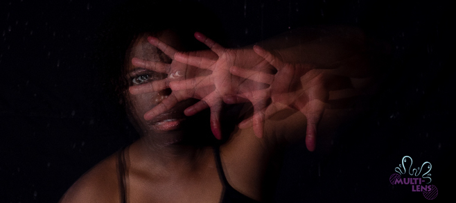 A manipulated photo of a black woman slightly out of focus. 3 handshapes partially cover her face illustrating different lenses through which her eyes shine through her splayed fingers. A Multi-Lens logo is present.